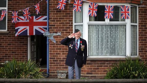 WWII veteran Bernard Morgan, aged 96, poses as he takes part in the VE day two minute silence outside his home and alongside neighbours on the street on May 08, 2020 in Crewe, United Kingdom.