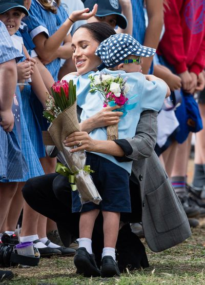 Luke Vincent steals Meghan's heart during the royals' visit to Dubbo