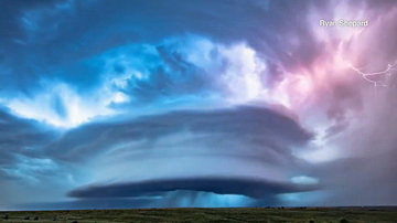 Time-lapse footage shows the supercell hovering over corn fields in Kansas.