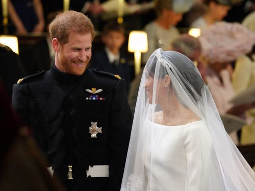 Harry and Meghan sharing a loving look during the ceremony. (AAP)