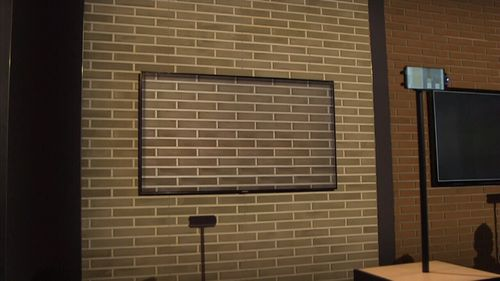 Using a combination of sensors and photos from your smartphone, the TV blends into your wall. (9NEWS)