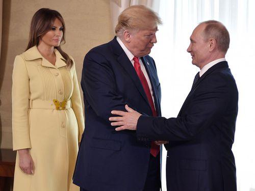 Melania Trump looks on as President Putin greets her husband.