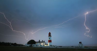 Lightning flashes over Souter lighthouse in South Shields as heavy thunderstorms gave some reprive from the heatwave last weekend in the UK.