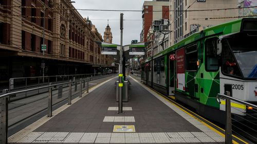 MELBOURNE, AUSTRALIA - JULY 16: A general view of an empty Flinders Street on July 16, 2021 in Melbourne, Australia. Lockdown restrictions have come into effect across Victoria as health authorities work to contain two COVID-19 outbreaks linked to Sydney's delta strain coronavirus cluster. The snap five-day lockdown, which came into effect at midnight on Thursday, was called after more new COVID-19 cases and exposure sites were confirmed across the state. Under the lockdown restrictions, Victori