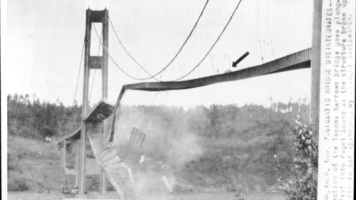 A huge section of the Tacoma Narrows bridge goes plunging 190 feet into Puget sound. Arrow points to a car stranded on the bridge.