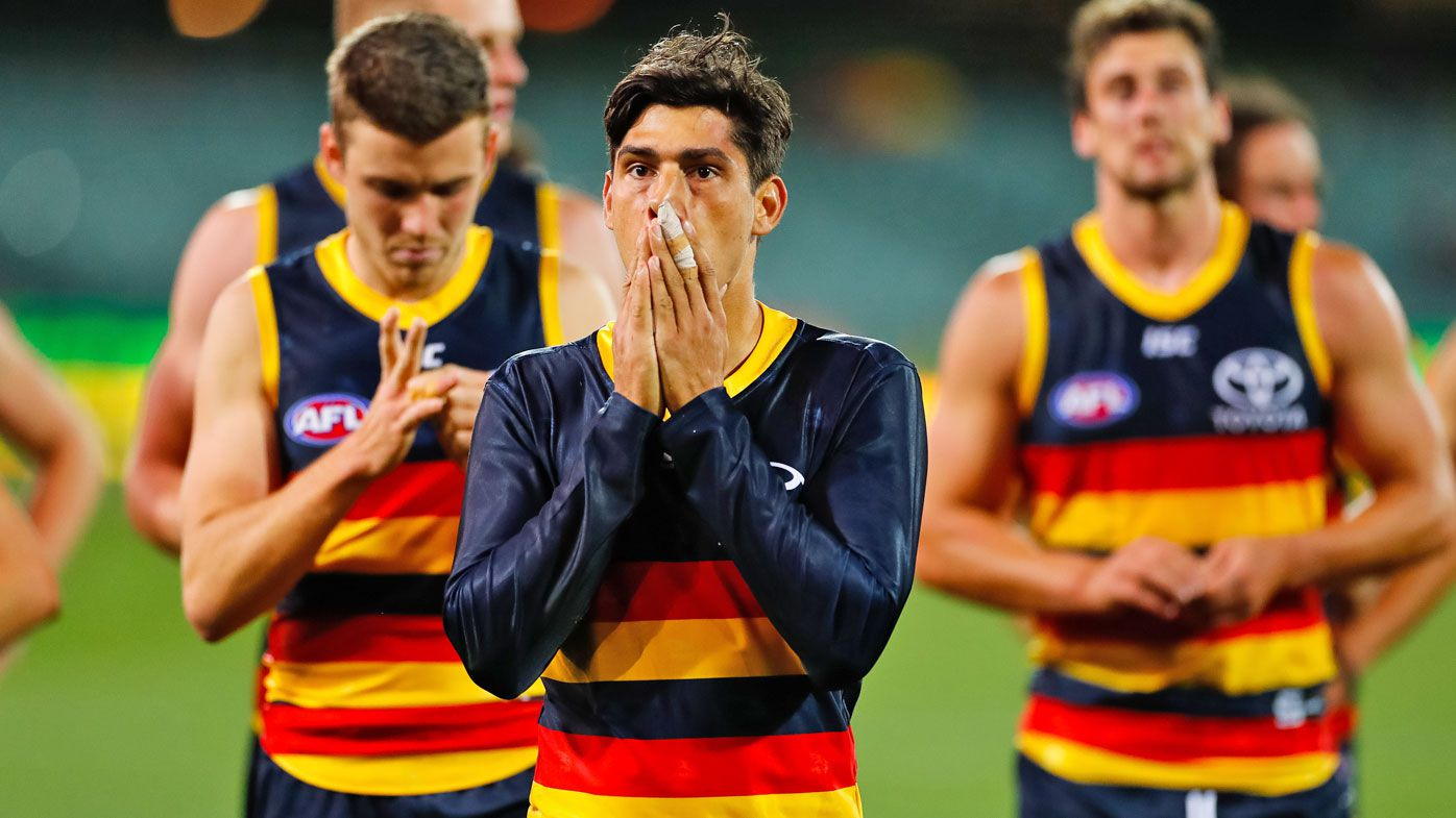 Shane McAdam of the Crows looks on dejected