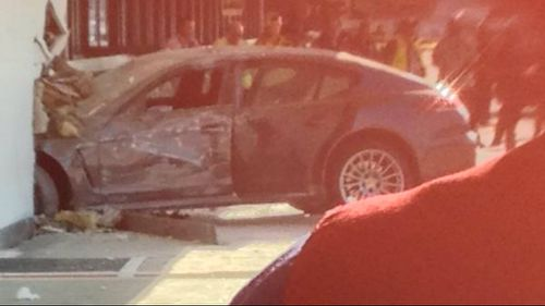 A girl has been injured after a car crashed into the wall at LAX. (@LTOKEN, Twitter)