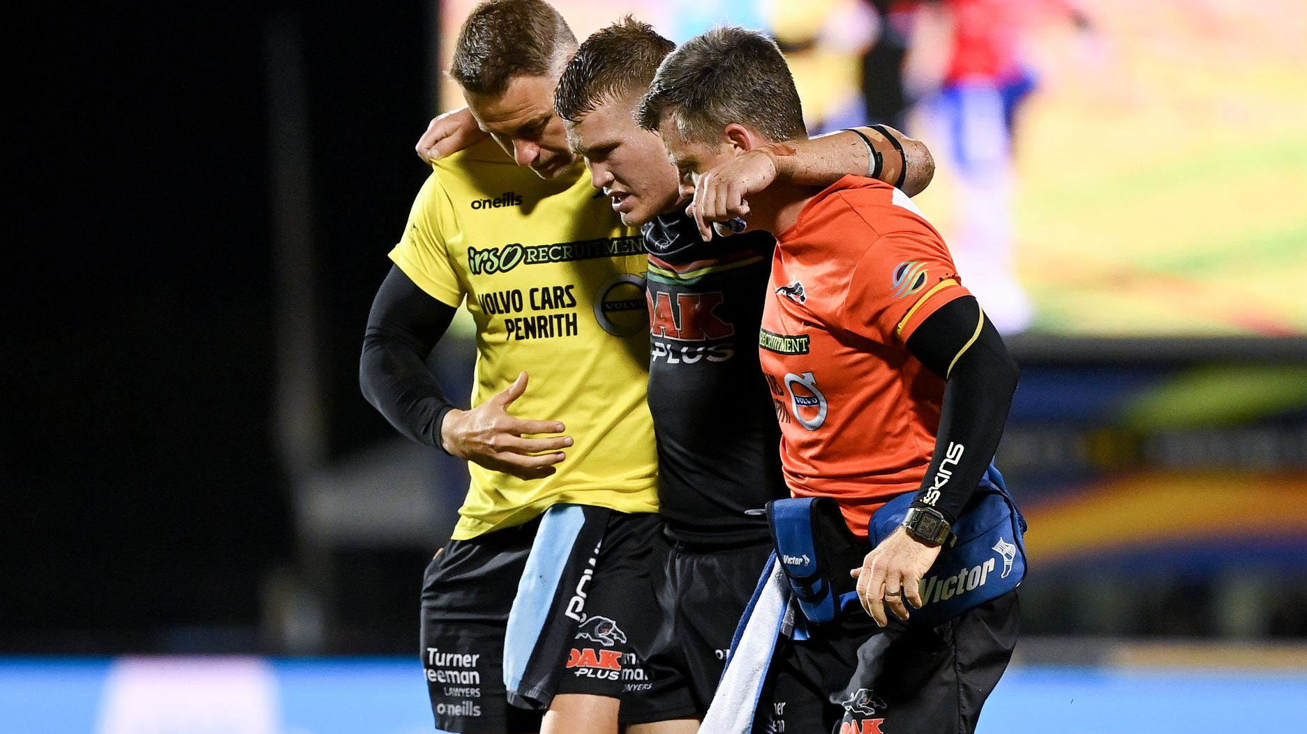 Mitch Kenny is helped from the field by his trainers. The Orange one is now banned.