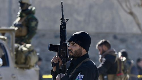 Afghan security officials secure the scene of a suicide bomb attack in Kabul, Afghanistan. (AAP)