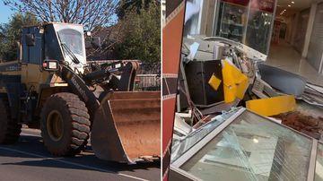 Front-end loader used as battering ram in bizarre break-in