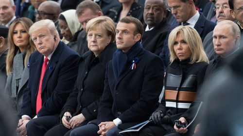 First lady Melania Trump, U.S. President Donald Trump, German Chancellor Angela Merkel, Emmanuel Macron and Brigitte Macron, Russian President Vladimir Putin attend a commemoration ceremony for Armistice Day.