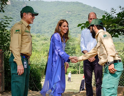 The soldier abandoned the salute to shake the Duchess' hand.