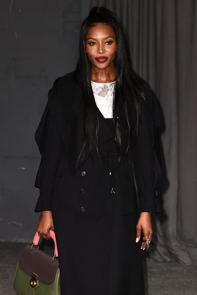Rich plum lips for Naomi Campbell.