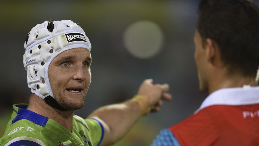 Raiders captain Jarrod Croker debates a controversial try with a referee. (AAP)