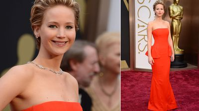 Everyone's best friend Jennifer Lawrence really pops on the red carpet with a bright red strapless gown.