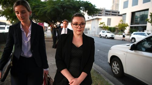 Thunder River Rapids ride operator Courtney Williams (right) leaves the inquest into the Dreamworld disaster at the Magistrates Court at Southport on the Gold Coast. Picture: AAP