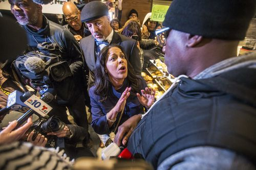Camille Hymes of pressure group Black Lives Matter protests in the store yesterday. Picture: The Philadelphia Inquirer/AAP