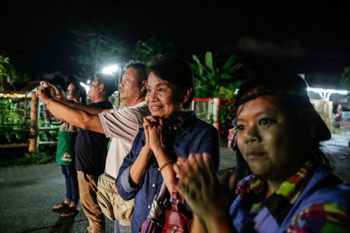 Parents of the trapped children wait patiently for their boys to be rescued from the cave. Picture: Getty