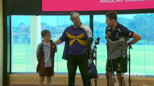 Heath, 12, was surprised by Dockers star Lachie Neale. (9NEWS)