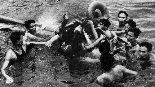 John McCain is rescued from his crashed plane by North Vietnamese people before being taken captive in 1967. (AAP)