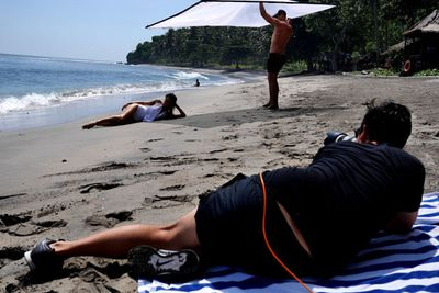 A smokin' hot Jen reclines on the sand - we know she works hard and all, but we're well jel that this is her day job!