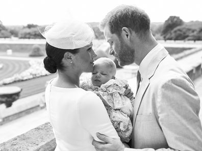 In one photograph taken by Chris Allerton, the Duke and Duchess of Sussex hold their son Archie Harrison Mountbatten-Windsor in the Rose Garden in Windsor Castle.