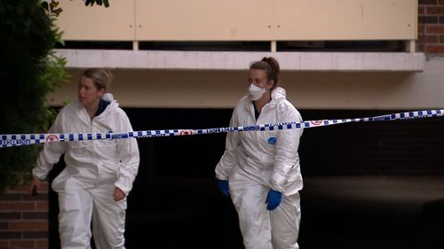 Forensic police at the Wentworthville unit.