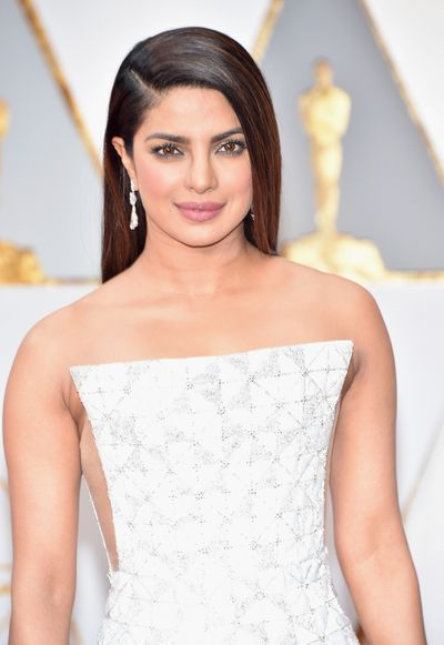 Priyanka Chopra was smoky, sophistication with rich, grey liner smudged along the upper and lower lash lines.