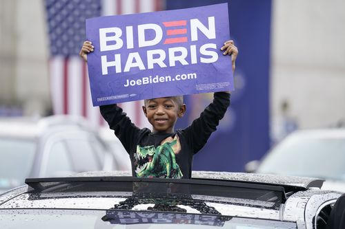 """Supporters attend a """"Souls to the Polls"""" drive-in rally for Democratic presidential candidate former Vice President Joe Biden, at Sharon Baptist Church"""
