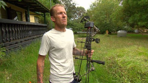 Joe patrols his local area with his compound bow and arrows.
