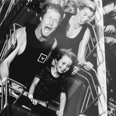 Richie Strahan, Elijah and Alex Nation on a rollercoaster in Melbourne.