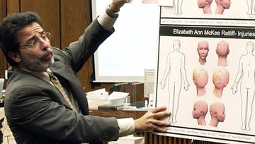 Defence attorney David Rudolf compares a diagram showing the wounds to the head of victim Kathleen Peterson