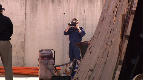 Police hope to find answers to the cold case buried under shipping containers in Bayswater.