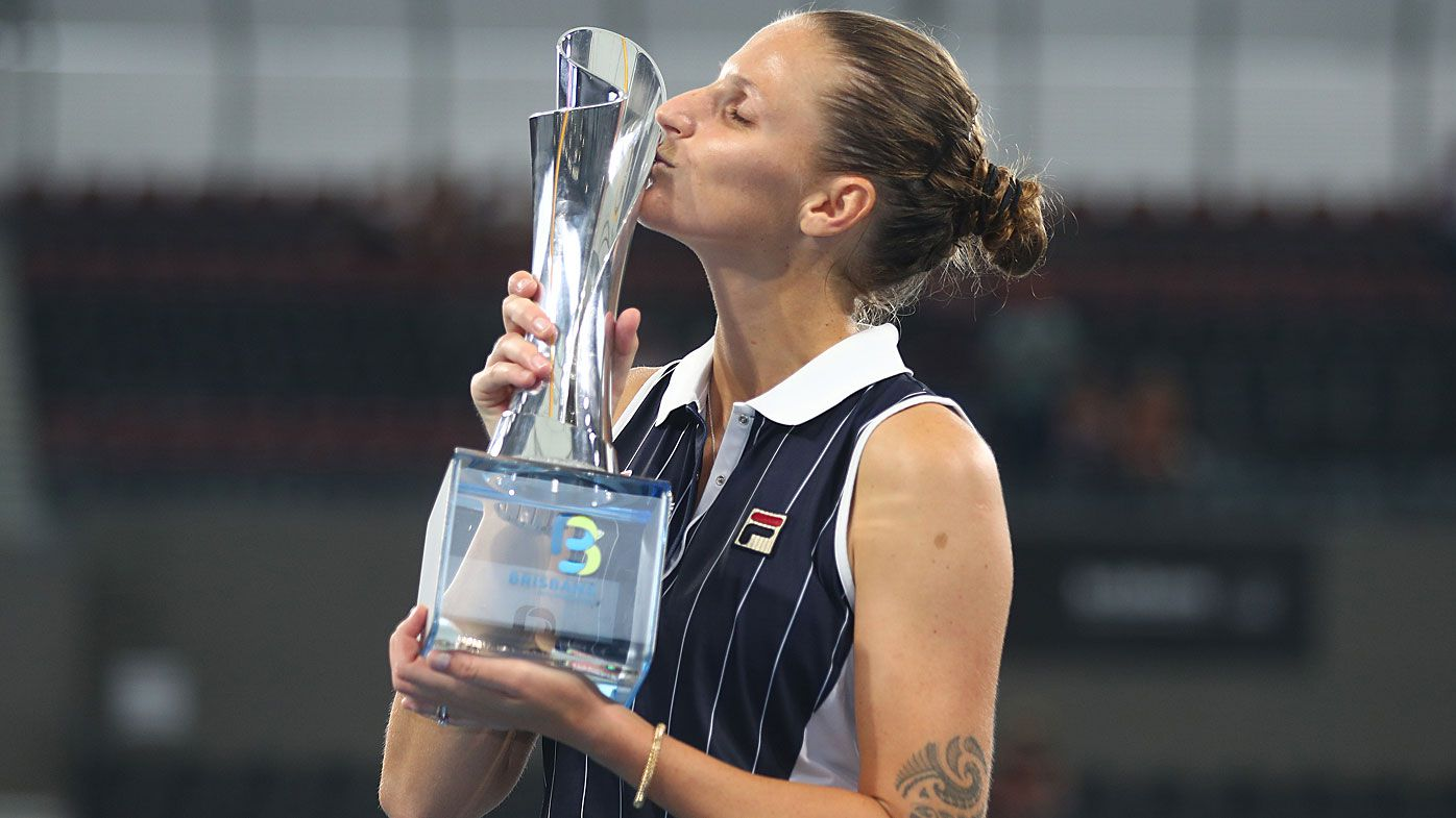 Karolina Pliskova of The Czech Republic kisses the winners trophy after the finals match against Madison Keys