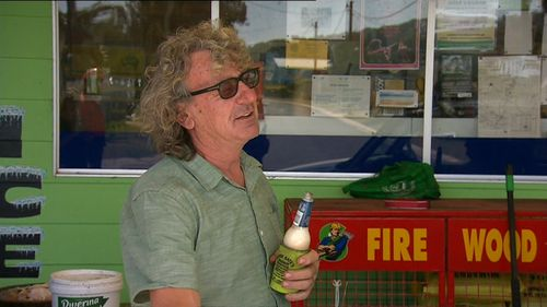 Petrol station owner Mick Prio stayed behind to protect the station against spot fires. (9NEWS)