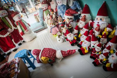 Santa Claus dolls for Christmas are for sale in a store at a wholesale market in Yiwu city.