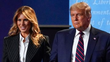 President Donald Trump and first lady Melania Trump hold hands on stage after the first presidential debate at Case Western University and Cleveland Clinic, in Cleveland, Ohio