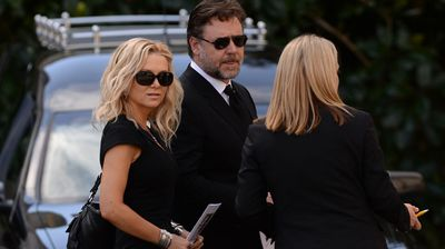 Russell Crowe and Danielle Spencer arrive at the funeral service for Kidman's father.