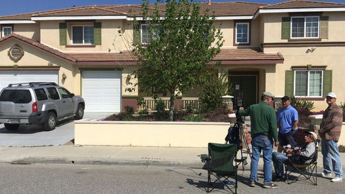 US media outside the outside the home of the YouTube shooter's parents in Menifee, California. (AP).