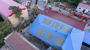 An aerial photo released by Xinhua News Agency, shows the collapsed two storey restaurant.