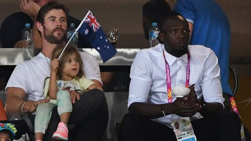 Australian Hollywood actor Chris Hemsworth and the world's fastest man Usain Bolt were seen together last night in the stands at the Commonwealth Games athletics events. Picture: AAP.