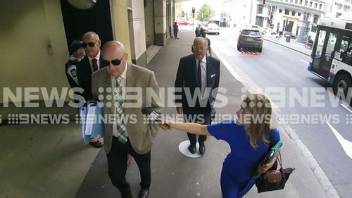 Chris Dawson (far left) arrives at court in Sydney this morning.