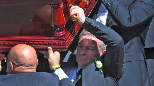 Borce Ristevski carried his wife's coffin at her funeral.