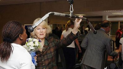 Camilla, Duchess of Cornwall watches pupils exercising during a tour of Copland Sports Centre at one of the country's top boarding schools, on January 30, 2006 in Westonbirt, England.