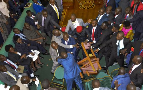 Politicians could be seen being hit with chairs during the brawl.