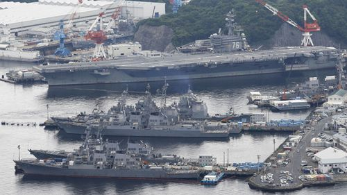 The nuclear-powered U.S. aircraft carrier Ronald Reagan (top) is seen in this photo taken from a Kyodo News helicopter on May 15, 2017, as it awaits deployment on a patrol mission from its home port in Yokosuka, southwest of Tokyo.