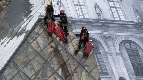 The Louvre Pyramid became the subject of a major installation. (AFP)