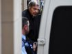 Jeers as Pell taken back to prison