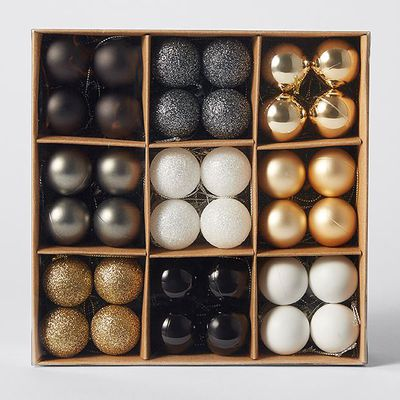"""<a href=""""https://www.target.com.au/p/mono-luxe-72-pack-small-christmas-baubles/60523945"""" target=""""_blank"""">Target Mono Luxe Baubles, $10.</a>"""