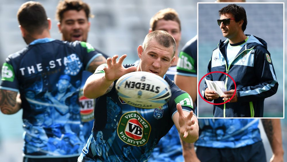 NSW players train at ANZ Stadium and (inset) Laurie Daley holds his notes. (Getty and AAP)
